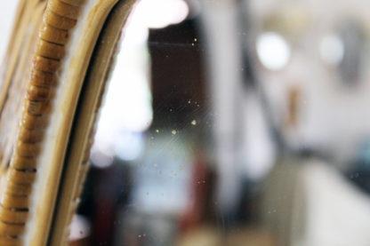 Miroir rond en osier tressé