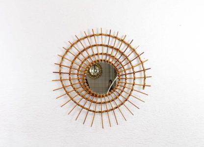 Grand miroir biseauté en rotin forme spirale